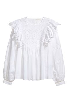 Blouse in woven fabric with eyelet embroidery. Ruffled collar, ruffled yoke, and opening at back of neck with a button. Long, wide sleeves and narrow cuffs with buttons. - Visit hm.com to see more.