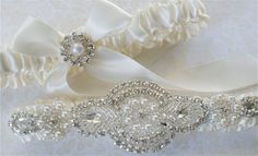 Wedding Garter Set Gorgeous Crystals, Pearl, and  Rhinestones Applique on Ivory Satin Bride Garter with Satin Tossing Garter. $49.00, via Etsy.