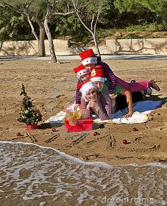 Mom...bring the Santa hats with you!  beach photo