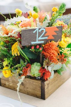 southwestern inspired table numbers, photo by Matthew Morgan http://ruffledblog.com/southwestern-san-clemente-wedding #centerpieces #southwestern #tablenumbers