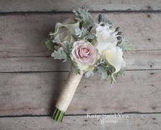 An arrangement of silk roses and dusty miller make the perfect winter wedding bouquet - now in a bridesmaids size!  Available for custom order from Kate Said Yes Weddings.