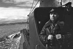 Captain 2nd Rank N. A. Lunin, the commander of the Russian submarine K-21, is seen on the bridge of his ship.