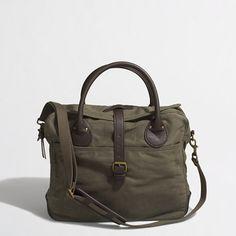 """<ul><li>Cotton twill, leather.</li><li>4"""" handle drop.</li><li>12 1/2""""H x 15""""W x 4""""D.</li><li>Removable shoulder strap with padded leather sleeve.</li><li>Exterior pockets, interior pockets.</li><li>Buckle and zip closure.</li><li>Import.</li></ul>"""