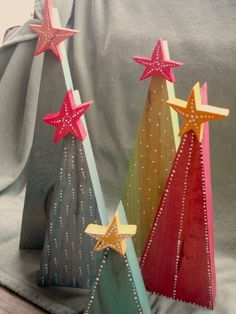 Primitive Wooden Christmas Trees with Stars.  The trees are made from found wood, stained, and painted with white dots. Pinterfest project?