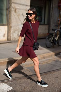 Shop this look on Lookastic:  http://lookastic.com/women/looks/crew-neck-t-shirt-skater-skirt-crossbody-bag-loafers-ring-sunglasses/10275  — Burgundy Crew-neck T-shirt  — Burgundy Skater Skirt  — Black Leather Crossbody Bag  — Black Leather Loafers  — Silver Ring  — Black Sunglasses