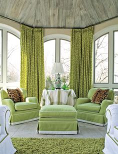 From Traditional Home, theselime green and white giraffe print curtains in a room designed by Lawrence Boeder.