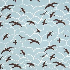 light blue monaluna organic fabric with seagulls and clouds