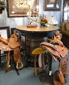 Western saddle bar stools. Perfect for dressing up your western home and putting those trophy saddles to good use.   Stylish Western Home Decorating