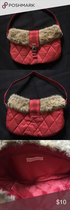 """Purse Dark red in color,depth of inside about 6 1/2"""",inside there are two open pockets & 1 pocket that zips,inside zipper pocket depth about 4"""",latches shut in front,fur around top base,straps length about 9"""" from top base of purse. There's a smelling marking inside at bottom from nail polish. No markings found other than that. Bath & body works Bags"""