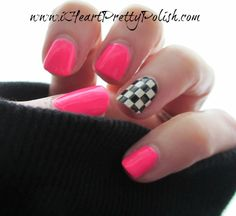 hot pink manicure with a black and white checkerboard accent nail