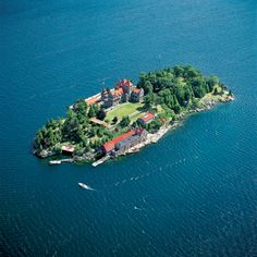 """Dark Island, a prominent feature of the Saint Lawrence Seaway, is located in the lower (eastern) Thousand Islands region, near Chippewa Bay. It is a part of the Town of Hammond, in St. Lawrence County, New York. An historic landmark here, """"The Towers"""" was long known as Dark Island Castle until recently renamed """"Singer Castle"""". The island is situated only a few yards south of the Canada-United States border that runs along the river. Because of its proximity to Canada, it was used for ..."""