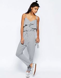 Image 1 ofASOS Jersey Jumpsuit with Peg Leg and Ruffle Detail