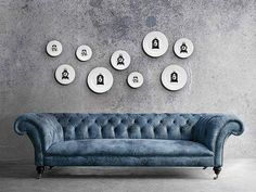 gray couch and clocks