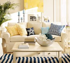 Navy striped rug + yellow pillows and picture (must paint my table like this in the family room!)