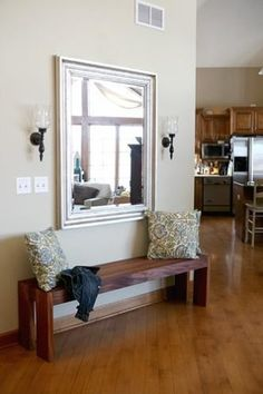 Simple DIY Bench. Right when you walk in, to the right of the stairs! It would be great to have!