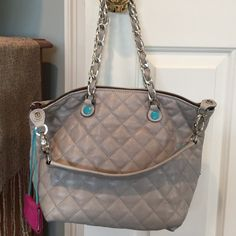 Made in Italy dove gray shoulder bag Quilted gray shoulder bag with turquoise button accents. Chain strap. Can be worn a few ways. Gab Bags Shoulder Bags