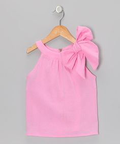 This crinkle sheer top features an easy-on zipper plus a shoulder bow for a look that combines comfortable with adorable. Timeless yet fresh, this versatile piece can be worn anywhere from the park to a birthday party.100% cottonMachine washImported