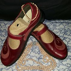 Mary Jane shoes w/swirl applique Pair of Mary Jane shoes in blood red, has velcro closure, swirl style applique on top of shoes, all leather, have a super comfy foot bed in them. This type didnt work for me. :( worn maybe 2xs,  Size: 41 (10) by  Naot  (made in Israel ) Naot Shoes Mules & Clogs