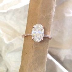 Oval engagement ring. featuring diamonds and Forever brilliant moissanite. Rose…