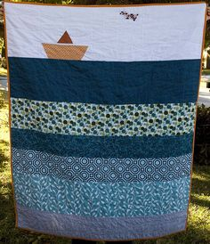 sailboat quilt. Could put some fish or a whale in this. Sun. cloud.