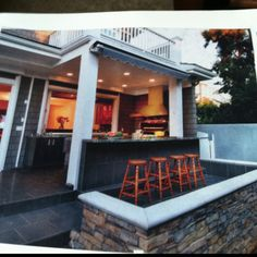 Outdoor kitchen......Bust out den wall and make an upstairs porch which would give the roof to the outdoor kitchen!  Sweet!!!!  B