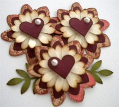 Description  This lovely set includes the following:    (3) 2 hand shaded flowers with a pop-up pearled heart center and (2) leaves      *I have shaded each flower with acid free distress ink for a more vintage look.    These embellishments are perfect for any scrapbooking or card making project!    If you are interested in other colors or styles please convo me and I will see what I can do