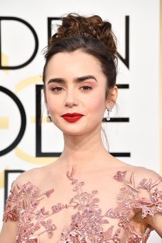 Actress Lily Collins attends the 74th Annual Golden Globe Awards wearing Harry Winston Diamonds. Discover the best jewellery red carpet celebrity looks from the 74th annual Golden Globe Awards: http://www.thejewelleryeditor.com/jewellery/article/golden-globes-red-carpet-jewellery-edit/ #jewelry