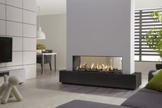modern high black white double sided gas fireplace for contemporary neutral house. Fantastic Double Sided Gas Fireplace Which Reaching Wide Range Corner Fireplace, Double Sided Gas Fireplace, Glass Fireplace, Fireplace Design, Living Room With Fireplace, Contemporary Fireplace, Fireplace Decor, Interior Design, House Interior