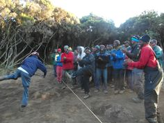 Day 7: Our porters dancing to their good-bye song. Jambo Bwana! Photo Gallery – Eva Melusine Thieme