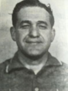 Rocco Mazzie aka Rogie, born in Pennsylvania 1916-died 1986. Mazzie was a capo in the Carlo Gambino family. In 1959 he got sent to prison for involvement in a heroin ring with big names like John Ormento, Vito Genovese, Carmine Galante and Natale Evola. A total of 36 mobsters were sentenced to jail. Other crimes on his sheet were robbery, assault.