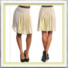 """3/4 HP NWT Chiffon Gray/Yellow Skirt Sz M Stand out with this fashionable skirt. Gray with peaking pleats of lemon yellow. Perfect for spring. Measures 21"""" in length, elastic waistband 13"""" expands to 18"""" or more. ***2 available, please ask for separate listing if you'd like to purchase*** Thanks for looking! Oh My Julian Skirts"""