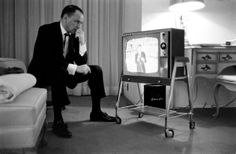 """I'm watching a Doc called """"Sinatra: All or Nothing at All.  It's very well made and has narratives by many of his friends and family.  This photo is In the Doc.  They're  Exactly the same.  But the doc says he's watching JFK's funeral - on screen this is a coffin, draped with a flag, being carried.  Life magazine said he was anxiously waiting for his son to emcee his first TV show.  Since Time magazine Took the photo it's hard to think it could be anything But what Time magazine says it is…"""