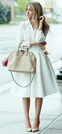 An all white look + achieve a gorgeous, feminine spring style + Cara Loren + utterly entrancing + simple but intricate style + A line skirt + white blouse.   Skirt: H&M, Shirt: Rachel Parcell.   http://www.justthedesign.com/cute-spring-outfit-ideas/