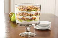 Snickers Trifle: Mix one 20-oz. can of pineapple tidbits and a 12-oz. container of whipped topping. Core apples and cut in half lengthwise. Slice the halves then cut into quarters. Toss apples with 3 tbsp. lemon juice. Chop 1 cup of peanuts and four candy bars. Spoon one-third of the whip mixture into the Trifle Bowl and spread evenly. Layer one-third of the apples, candy bar pieces and peanuts. Repeat twice.