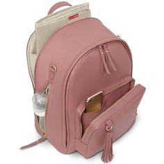 Skip Hop's Greenwich diaper backpack has 9 pockets, including a large zippered main compartment and front and side zip pockets.