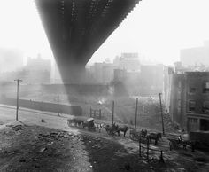Shadows are cast beneath the Brooklyn Bridge, seen from a stable roof, on May 6, 1918. (Eugene de Salignac/Courtesy NYC Municipal Archives)  via theatlantic.com