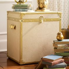 Inspired by an antique steamer trunk, this handsome piece is upholstered in soft linen for a beautiful vintage vibe. The top offers plenty o...