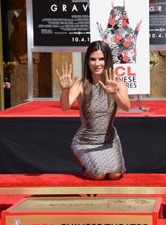#SandraBullock poses for a photo as she is immortalized with a hand and footprint ceremony at #TCLChineseTheatre on September 25, 2013 in Hollywood, California. http://celebhotspots.com/hotspot/?hotspotid=25124&next=1