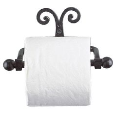 """Wrought with twists and curls this piece is hand crafted to beautifully hold your toilet tissue.brbrliDimensions: 7.5""""w x 4.5""""d x 3.5""""hliBRBRA HREF=""""http:www.ironaccents.com68.html""""S..."""