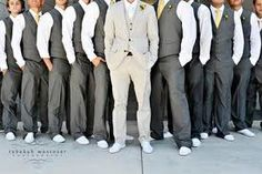 The look Anthony Likes - only he would be in Charcoal as well. Groomsmen in vests, Groom in a jacket. Yellow ties.