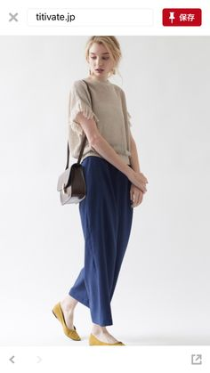 beige fringe knit,blue wide pants,black bag,mastered yellow flat shoes
