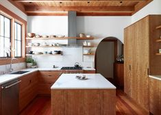 Floor to ceiling cabinetry. A floor-to-ceiling armoire-like cabinet adds height and additional storage in a renovated kitchen in Oakland (see more at Kitchen of the Week: Aya Brackett's Hippie House). Photograph by Aya Brackett. Natural Wood Kitchen Cabinets, Wood Cabinets, Kitchen Wood, Kitchen Cabinetry, Soapstone Kitchen, Kitchen Interior, New Kitchen, Kitchen Decor, Kitchen Ideas