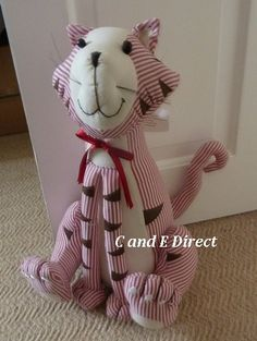 Sell one like this  Large Fabric Cat Stripey Doorstop Door Stop Red & Whit