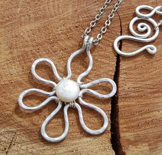 Silver Aluminum Pearl Flower Chain by Karismabykarajewelry on Etsy. $24.00, via Etsy.