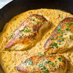 Creamy Roasted Red Pepper Chicken Skillet Recipe Main Dishes with boneless skinless chicken breasts, butter, diced onions, garlic cloves, roasted red peppers, chicken broth, low-fat cream cheese, crushed red pepper, basil leaves