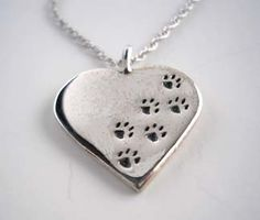 Paw Prints Across Your Heart Necklace in Sterling Silver