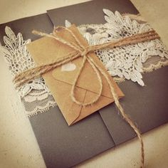 beautiful handmade invitation..love the lace..the string..the brown paper..well, everything about it!!