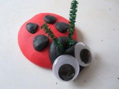 Play Dough Ladybug- could use black beans for spots and black button head. the eyes could be glued on the buttons. Pipe cleaners for antennae. Can roll a die and add spots to your ladybug, draw or spin a number.