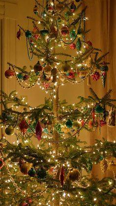 This is exactly the kind of skinny, charlie brown tree my grandma had at her house every year.  Fond memories!