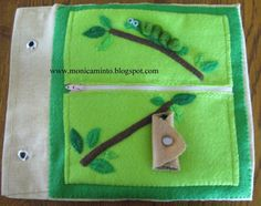 Quiet book page. The cocoon opens up into a butterfly. Zipper pocket holds interchangeable wings.